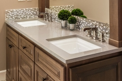 Bathroom Detail in New Luxury Home: Double Vanity with Two Sinks, Faucets, Cabinets, and Mirror
