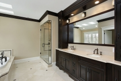 Master bath with dark cabinetry