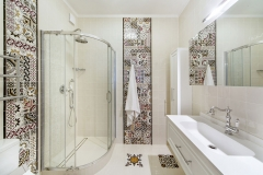 interior of a bathroom with shower and washbasin